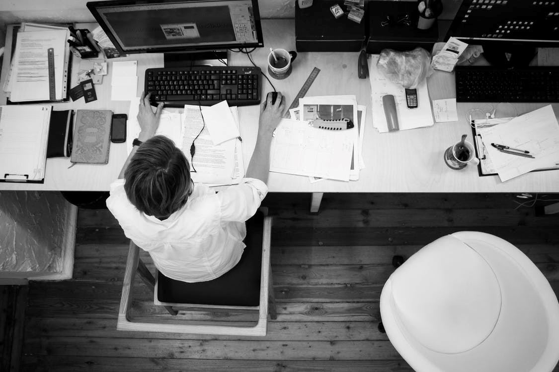 Overhead view of person working at a desk JPEG